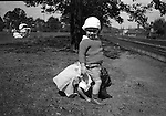 Pittsburgh PA:  Helen and Brady Stewart Jr playing leap frog in the park - 1922