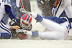 3 January 2010: Buffalo Bills' quarterback Ryan Fitzpatrick (14) on a keeper play against the Indianapolis Colts on a cold, snowy, final game of the season at Ralph Wilson Stadium in Orchard Park, New York. The Bills defeated the Colts 30-7. Mandatory Credit: Ed Wolfstein Photo