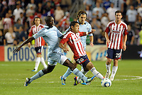 Chivas Guadaljara midfielder Marco Fabian (8) in between Lawrence Olum (13) and Graham Zusi (8) Sporting KC... Sporting Kansas City and Chivas Guadalajara played to a 2-2 tie in an international friendly at LIVESTRONG Sporting Park, Kansas City, Kansas.