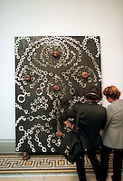 """Afrobluff"" by Chris Ofili at the Brooklyn Museum Sensation show on September 30, 1999. The painting uses pieces of elephant dung. (© Richard B. Levine)"