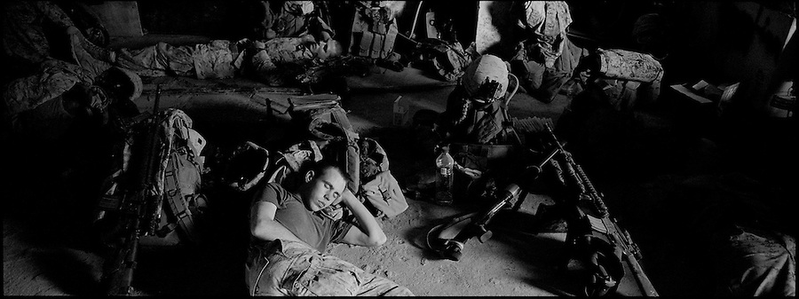 A Marine from of Alpha Co. 1st Battalion 6th Marines catches a little shut eye at the company's observation post in Ramadi, Iraq on Fri. Oct. 13, 2006.