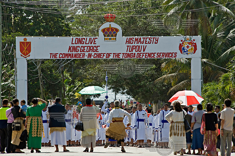 Following the coronation of King George Tupou V, the Tongan military band, along with foreign military bands and children's school bands, marched through the streets of Nuku'alofa.