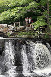 Southbury, CT- 21 June 2015-0602115CM01-  Eril Eti, left, holds Demir, 3 with his wife Envera Eti, and their daughter  Derya 2, all of Southbury, as they overlook the falls at Southford Falls State Park in Southbury on Sunday.  The family was out enjoying the afternoon as sun broke out following an overcast start to the day.  According to the National Weather Service, Monday is expected to be mostly sunny, with a high near 85.   Christopher Massa Republican-American