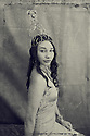 B&amp;W altered image. Portrait of an impassive beautiful young woman wearing a  tall heart crown.