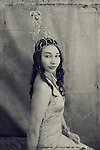 B&W altered image. Portrait of an impassive beautiful young woman wearing a  tall heart crown.