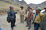 Freddy Llanos, a professor of mining engineering at Tomas Frias University, talks with local residents outside the Kumurana Mine near Caiza D, Bolivia. The mine, which is closed, produces highly toxic acid runoff that negatively impacts the farms and lives of people living downstream. Llanos is working with an international coalition that is working with local miners and farmers to clean up the mine's runoff.