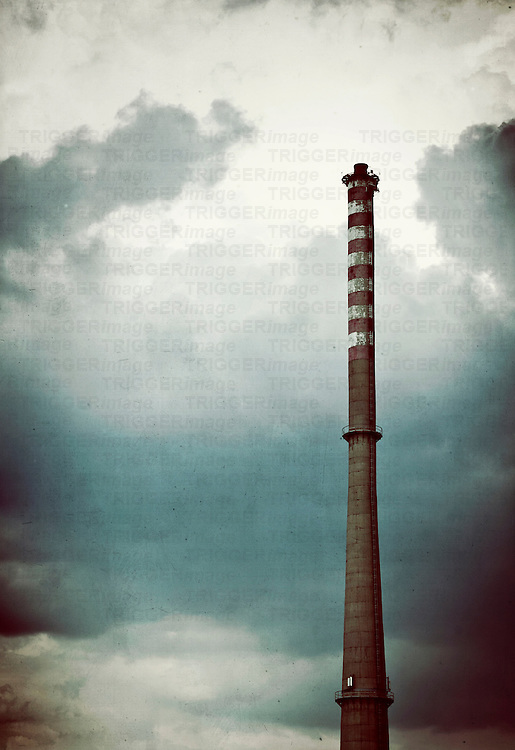 Navy blue sad sky and tragic clouds with high industrial chimney