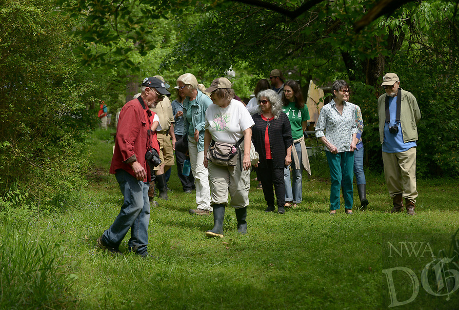 NWA Democrat-Gazette/BEN GOFF @NWABENGOFF<br /> Burnetta Hinterthuer of Fayetteville, a professor at Northwest Arkansas Community College and member of the Arkansas Native Plant Society, leads a plant discovery walk Sunday, April 16, 2017 during the 13th annual Earth Day celebration at World Peace Wetland Prairie in Fayetteville. The event hosted by the Omni Center for Peace, Justice and Ecology included guided nature hikes in the park, live music, and other nature activities for all ages.