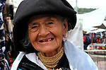 A women poses for a portrait  at the Plaza de Ponchos  Market, Otavalo, Ecuador.