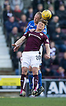 Hearts v St Johnstone&hellip;19.03.16  Tynecastle, Edinburgh<br />Steven Anderson gets above Gavin Reilly<br />Picture by Graeme Hart.<br />Copyright Perthshire Picture Agency<br />Tel: 01738 623350  Mobile: 07990 594431