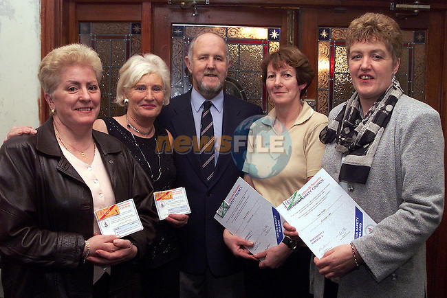 Kathleen Matthews, Francis Farrell who recieved Swim 1 - 5 certs and with Dave Moloney, Moira O'Brien and Mary Taaffe who recieved Survival 2 certs at the Louth Water Safety awards night.Pic Paul Mohan Newsfile..Camera:   DCS620C.Serial #: K620C-01974.Width:    1728.Height:   1152.Date:  5/12/99.Time:   17:24:04.DCS6XX Image.FW Ver:   1.9.6.TIFF Image.Look:   Product.Tagged.Counter:    [499].Shutter:  1/40.Aperture:  f8.0.ISO Speed:  200.Max Aperture:  f1.8.Min Aperture:  f22.Focal Length:  50.Exposure Mode:  Manual (M).Meter Mode:  Color Matrix.Drive Mode:  Continuous High (CH).Focus Mode:  Continuous (AF-C).Focus Point:  Center.Flash Mode:  Normal Sync.Compensation:  +0.0.Flash Compensation:  +0.0.Self Timer Time:  10s.White balance: Auto (Flash).Time: 17:24:04.751.