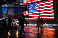 People walk at Times Square, NY, during a day of 4 inches of snow and almost 1/2 of ice which made this Wednesday a hard commute for people around New York and New Jersey. Jan 05, 2014. Photo by Eduardo Munoz Alvarez/VIEWpress