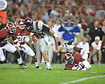 Ole Miss quarterback Bo Wallace (14) vs. Alabama defensive lineman Quinton Dial (90) at Bryant-Denny Stadium in Tuscaloosa, Ala. on Saturday, September 29, 2012. Alabama won 33-14. Ole Miss falls to 3-2.