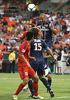 WASHINGTON, DC - July 28, 2012:  Chris Pontius (13) of DC United is beaten on a header by Alex (13) of PSG (Paris Saint-Germain) in an international friendly match at RFK Stadium in Washington DC on July 28. The game ended in a 1-1 tie.