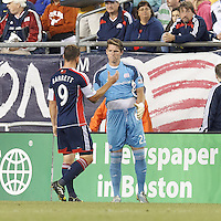 New England Revolution substitute goalkeeper Bobby Shuttleworth (22) enters to replace red card ejected starting goalkeeper. New England Revolution midfielder Chad Barrett (9) substituted out. In a Major League Soccer (MLS) match, Montreal Impact (white/blue) defeated the New England Revolution (dark blue), 4-2, at Gillette Stadium on September 8, 2013.