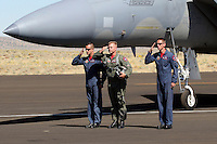 Major Jason 'Bondo' Costello stands and salutes with the airplanes two groundcrewman after a successful flight demonstration. Flying the F-15 Eagle, and assigned to the F-15 East Coast Demonstration Team, Costello demonstrated the performance charecteristics of the aircraft during the 2006 Reno Air Races. In December of 2006 the F-15 East Coast Demonstration Team began its transition to the F-22 Raptor. Photographed 09/06