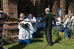Church Clipping Ceremony St Peters Church Edgmont Shropshire Uk 2015.<br /> <br /> The congregation hold hands, in a circle around the whole of the church, if they can, they did just in 2015, with the use of belts and ropes to complete the unbroken circle.