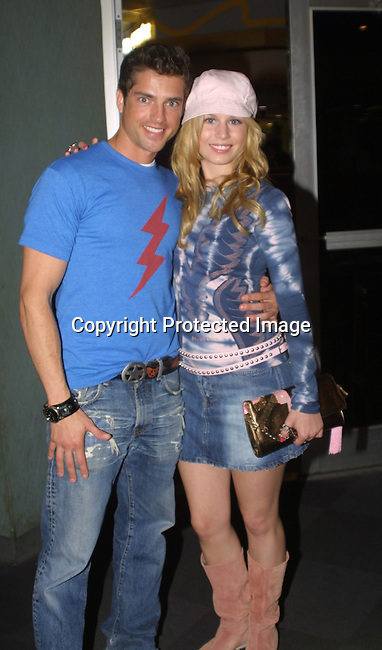 """Scott Bailey (Sandy) and Stephanie Gatschet (Tammy) at the """"Bloss and Friends"""" bowling event hosted by Jerry verDorn (Ross) and Liz Kiefer at the Port Authority Bowling lanes to benefit the Cancer Foundation on October 9, 2004 (Photo by Sue Coflin)"""