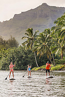 A family learns to standup paddle at Wailua River, Kaua'i.
