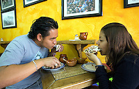 Mexico (04.04.2006)  A couple of customers eat tostadas of salpicon ( a fried tortilla seasoned  with ripped meat, avocado, onion and chile) in a Mexico City's restaurant,  April 04, 2006.  Photo by © Javier Rodriguez
