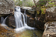 Thompson Falls in Pinkham Notch of the New Hampshire White Mountains during the autumn months. This waterfall is located on Thompson Brook