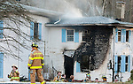MIDDLEBURY,  CT-122716JS04--MIddlebury firefighters work on battling a fatal house fire at a two-family home at 165 Whittemore Road in MIddlebury on Tuesday. <br /> Jim Shannon Republican-American