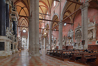 Nave of the Basilica of San Giovanni e Paolo, built 1430s in Italian Gothic style, Venice, Italy, with medieval and Renaissance wall tombs. The church is dedicated to 2 early Christian martyrs, John and Paul. 25 Doges have been buried here since the 15th century. The city of Venice is an archipelago of 117 small islands separated by canals and linked by bridges, in the Venetian Lagoon. The historical centre of Venice is listed as a UNESCO World Heritage Site. Picture by Manuel Cohen