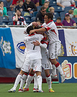 DC United midfielder Chris Pontius (13) celebrates his goal with teammates. In a Major League Soccer (MLS) match, DC United defeated the New England Revolution, 2-1, at Gillette Stadium on April 14, 2012.