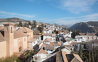 El Albayzin, the Moorish old town and on the left, the Convento de Santa Isabel la Real, built in the 16th century in Mudejar style, Granada, Andalusia, Southern Spain. From the 8th to the 15th centuries, Granada was under muslim rule and retains a distinctive Moorish heritage. Granada was listed as a UNESCO World Heritage Site in 1984. Picture by Manuel Cohen