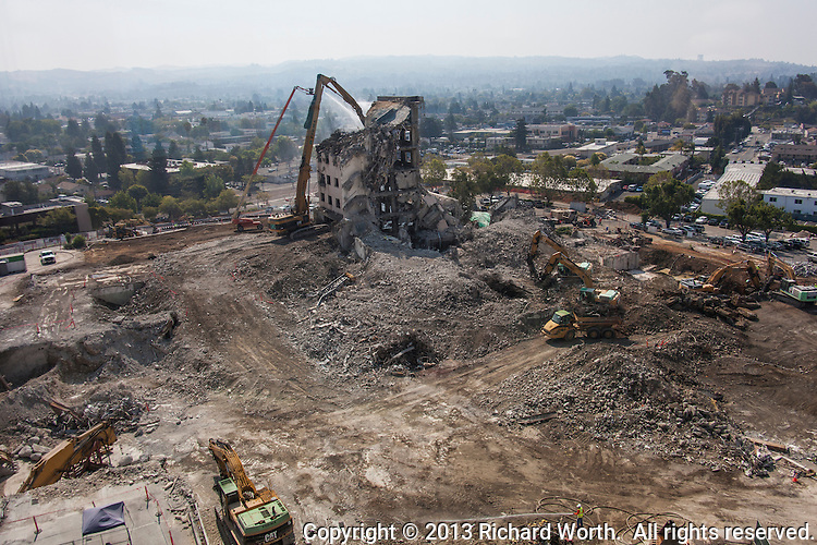 "Demolition or deconstruction, is progressing on the former Eden Hospital in Castro Valley, California.  The new Eden Medical Center opened December 1, 2012.  Summit Health calls the process deconstruction, ""because of the selective, targeted work involved and the recycling process—"""