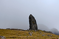 The Old Man of Storr with Quiraing enshrouded in fog, Isle of Skye, Scotland.