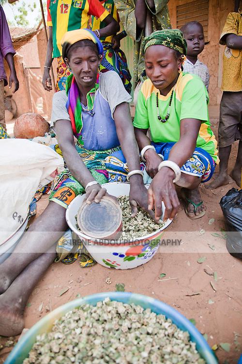 In the town of Djibo in northern Burkina Faso, women sell dried okra in the market.