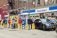 A Mobil gas station in the Greenwich Village neighborhood of New York on Sunday, January 22, 2017. With rising real estate values in Manhattan the number of gas stations has been steadily shrinking over the years. This particular Mobil station is the last remaining gas station in Manhattan below 14th Street.  (© Richard B. Levine)