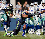Dallas Cowboys' tight end Jason Witten is stripped of the ball after being hit by Seattle Seahawks strong safety Kam Chancellor at CenturyLink Field in Seattle, Washington on September 16, 2012.  The Seahawks beat the Cowboys 27-7.  ©2012. Jim Bryant Photo.