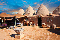 "Pictures of the beehive adobe buildings of Harran, south west Anatolia, Turkey.  Harran was a major ancient city in Upper Mesopotamia whose site is near the modern village of Altınbaşak, Turkey, 24 miles (44 kilometers) southeast of Şanlıurfa. The location is in a district of Şanlıurfa Province that is also named ""Harran"". Harran is famous for its traditional 'beehive' adobe houses, constructed entirely without wood. The design of these makes them cool inside. 19"