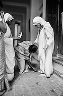 "January 1976, Calcutta, India --- Mother Teresa visits patients at her free hospice for the poor in Calcutta. The first Home for the Dying opened in 1952 and was a free hospice for the poor. Mother Teresa (Agnes Gonxha Boyaxihu) the Roman Catholic, Albanian nun revered as India's ""Saint of the Slums"", was awarded the 1979 Nobel Peace Prize. --- Image by © JP Laffont"