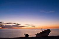 Small fishing boat on beach at sunrise, San Felipe, Baja California, Mexico