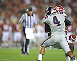 Ole Miss linebacker Denzel Nkemdiche (4) hits Alabama wide receiver Kevin Norwood (83), causing a fumble,  at Bryant-Denny Stadium in Tuscaloosa, Ala. on Saturday, September 29, 2012.