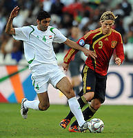 Fernando Torres (9) of Spain and Fareed Majeed (4) of Iraq battle for the ball. Spain defeated Iraq 1-0 during the FIFA Confederations Cup at Free State Stadium, in Mangaung/Bloemfontein South Africa on June 17, 2009.