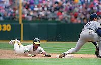 Baseball: Oakland Athletics Rickey Henderson steals base number 939, making him the all-time stolen base leader during game vs New York Yankees. Oakland, CA 5/1/1991 MANDATORY CREDIT: Brad Mangin/Sports Illustrated