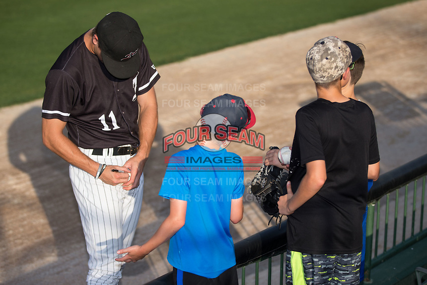 Jameson Fisher (11) of the Kannapolis Intimidators autographs a baseball for a fan prior to the game against the Hickory Crawdads at Kannapolis Intimidators Stadium on May 18, 2017 in Kannapolis, North Carolina.  The Crawdads defeated the Intimidators 6-4.  (Brian Westerholt/Four Seam Images)