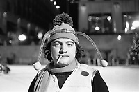1975, Manhattan, New York, New York, USA --- Comedian John Belushi, in a bumble bee costume, skates at the Rockefeller Center Ice Rink for a skit on Saturday Night Live. --- Image by &copy; Owen Franken/CORBIS