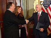 United States Representative Mike Pompeo (Republican of Kansas), left, is congratulated by US Vice President Mike Pence, right, after being sworn-in as Director of the Central Intelligence Agency (CIA) in the Vice President's ceremonial Office at the White House in Washington, DC on Monday, January 23, 2017.  Pompeo was accompanied by his wife, Susan, center.<br /> Credit: Ron Sachs / Pool via CNP