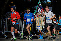New York City, NY. 02 November 2014.A Runner from Mexico (3 L-R) attends the 29th New York City Marathon as he arrives to Central park.