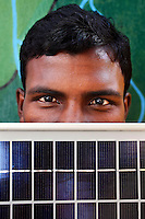 20 year old Rohim Miniaka is being trained in solar engineering and taught how to make solar lamps by the Orissa Tribal Women Barefoot Solar Engineers Association in the village of Tinginapu. The Orissa Tribal Empowerment and Livelihoods Programme (OTELP), an organisation funded by DFID (Department for International Development) and run with the state government of Orissa, has trained four women in solar engineering, and these women are now training others in the community.
