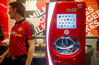 """Self-service drink machine with Coca-Cola products at the new Steak 'n Shake Signature restaurant in New York on its grand opening day, Thursday, January 12, 2012. The popular midwest chain opened its first New York outpost with a new concept for the restaurant, a smaller footprint and counter-only service, hence their """"Signature"""" branding. Founded in 1934 the company has nearly 500 restaurants with this one in New York being next to the Ed Sullivan Theatre where the Late Show with David Letterman Show is taped. (© Frances M. Roberts)"""