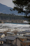 Photos show the tsunami as it hits the main part of the city of Rikuzentakata, Iwate Prefecture, Japan on March 11, 2011. The photos were taken from high ground by soy sauce company Yanagisawa Shoten employee Fumie Abe. .Photographer: Fumie Abe