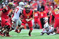 Backup quarterback Caleb Rowe scrambles out of the pocket. Ohio State trounced Maryland 52-24 during a game at the Capital One Field in Byrd Stadium, College Park, MD on Saturday, October 3, 2014.  Alan P. Santos/DC Sports Box