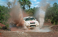 Competing car throwing water up while crossing a stream at the Rally dos Sertoes 2009, Brazil
