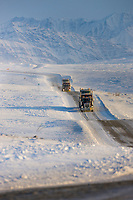 Semi tractor trailer travels the James Dalton Highway near Toolik, Brooks range mountains, arctic, Alaska.